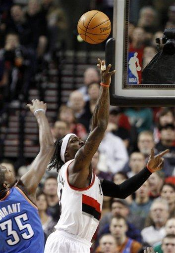 Portland Trail Blazers forward Gerald Wallace, right, goes to the hoop against Oklahoma City Thunder forward Kevin Durant during the first half of their NBA basketball game in Portland, Ore., Monday, Feb. 6, 2012.(AP Photo/Don Ryan)