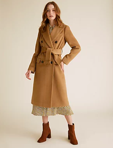 """<p><a class=""""link rapid-noclick-resp"""" href=""""https://go.redirectingat.com?id=127X1599956&url=https%3A%2F%2Fwww.marksandspencer.com%2Fbelted-double-breasted-longline-trench-coat%2Fp%2Fclp60455304%3Fcolor%3DCARAMEL&sref=https%3A%2F%2Fwww.redonline.co.uk%2Ffashion%2Fshopping%2Fg34625942%2Fmarks-and-spencer-womenswear-sale%2F"""" rel=""""nofollow noopener"""" target=""""_blank"""" data-ylk=""""slk:SHOP HERE"""">SHOP HERE</a> <strong>Was £99, Now £69.30</strong></p><p> Give a stylish finish to any autumn outfit with this timeless trench coat, made with wool to give a premium look and feel. </p>"""