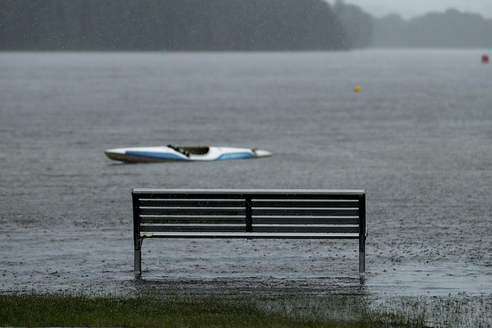 A park bench is flooded at Narrabeen Lake on the Northern Beaches in Sydney on Saturday. Source: AAP