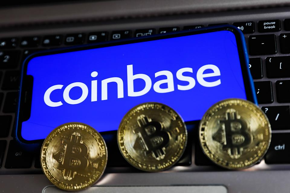 Coinbase logo displayed on a phone screen and representation of Bitcoin are seen in this illustration photo taken in Krakow, Poland on April 15, 2021 (Photo by Jakub Porzycki/NurPhoto via Getty Images) (Photo: NurPhoto via Getty Images)