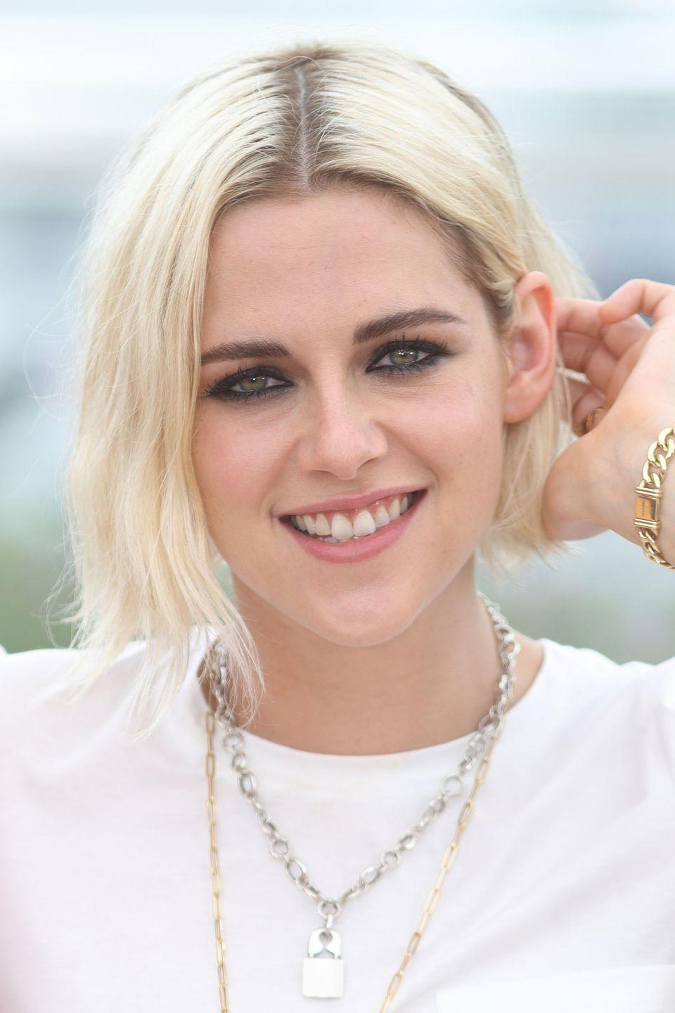 <p>Kristen Stewart gave bleached blonde hair a grungey update with grown out roots.</p>