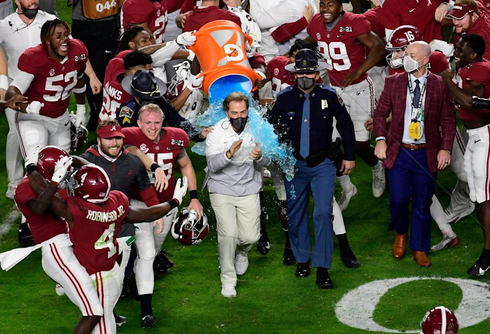 Crimson Tide head coach Nick Saban is dunked with Gatorade after defeating the Ohio State Buckeyes in the 2021 College Football Playoff National Championship Game.