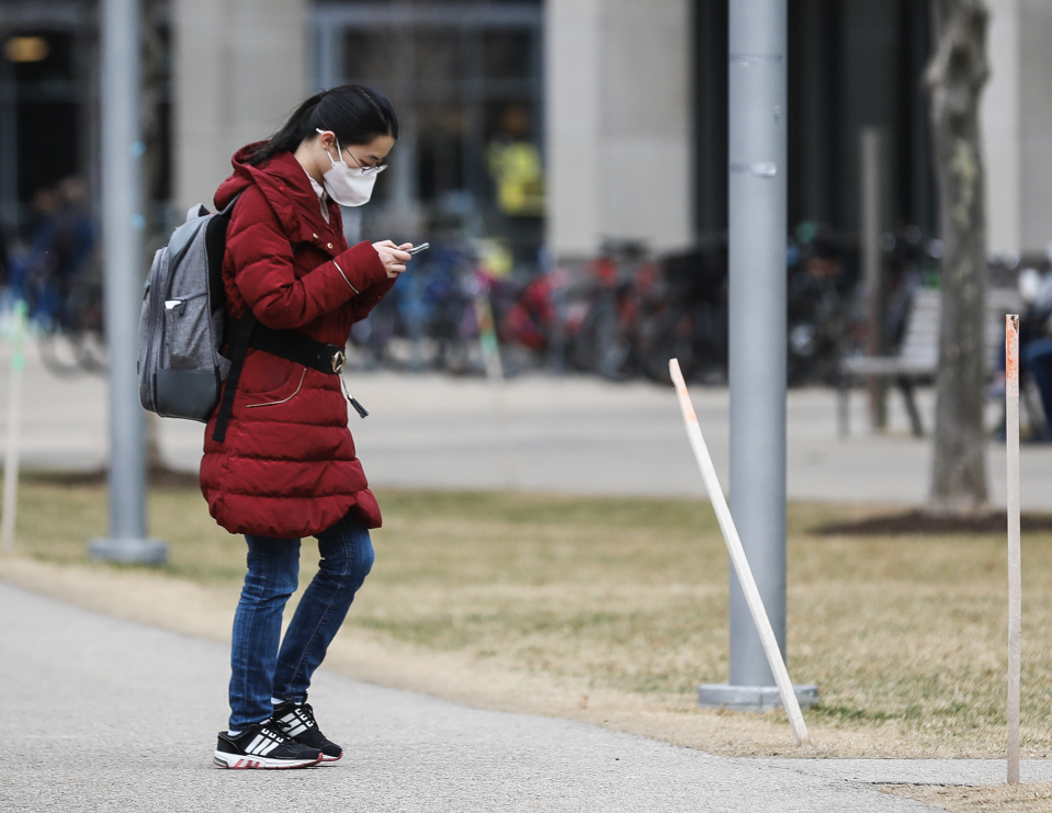 A person wears a mask while walking though MIT's campus in Cambridge, MA on March 10, 2020. (Photo: Erin Clark for The Boston Globe via Getty Images)