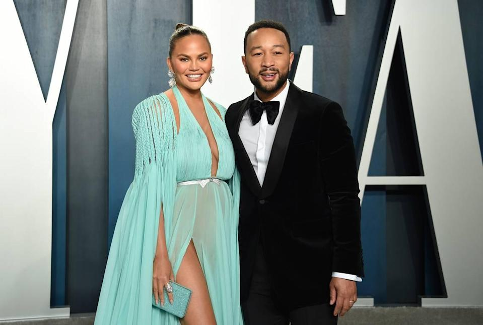 FILE - Chrissy Teigen and John Legend arrive at the Vanity Fair Oscar Party last year in Beverly Hills, Calif. (Photo by Evan Agostini/Invision/AP, File)