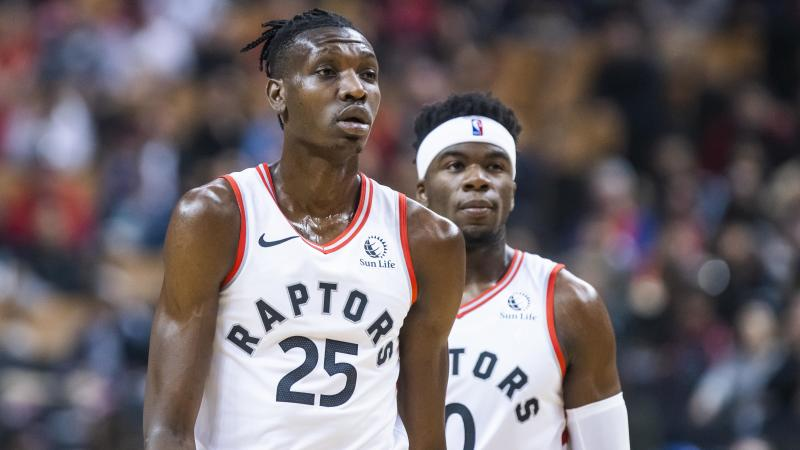 TORONTO, ONTARIO - OCTOBER 13: Chris Boucher #25 and Terence Davis #0 of the Toronto Raptors during a break agains the Chicago Bulls during their NBA basketball pre-season game at Scotiabank Arena on October 13, 2019 in Toronto, Canada. NOTE TO USER: User expressly acknowledges and agrees that, by downloading and or using this photograph, User is consenting to the terms and conditions of the Getty Images License Agreement. (Photo by Mark Blinch/Getty Images)