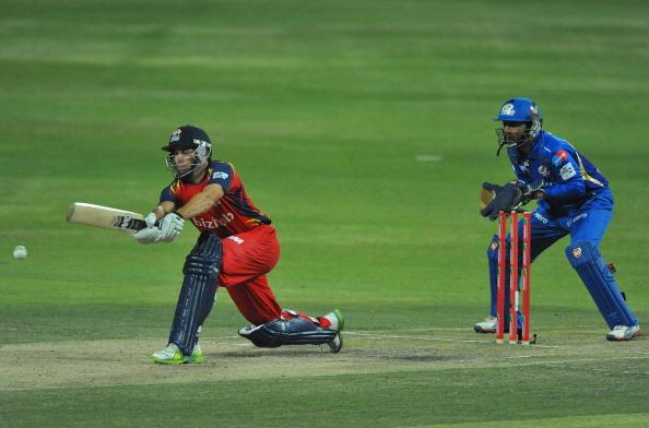 JOHANNESBURG, SOUTH AFRICA - OCTOBER 14:  Neil McKenzie of the Lions sweeps as wicketkeeper Dinesh Karthik (R) of the Indians looks on during the Karbonn Smart CLT20 match between Highveld Lions and Mumbai Indians at Bidvest Wanderers Stadium on October 14, 2012 in Johannesburg, South Africa.  (Photo by Duif du Toit/Gallo Images/Getty Images)