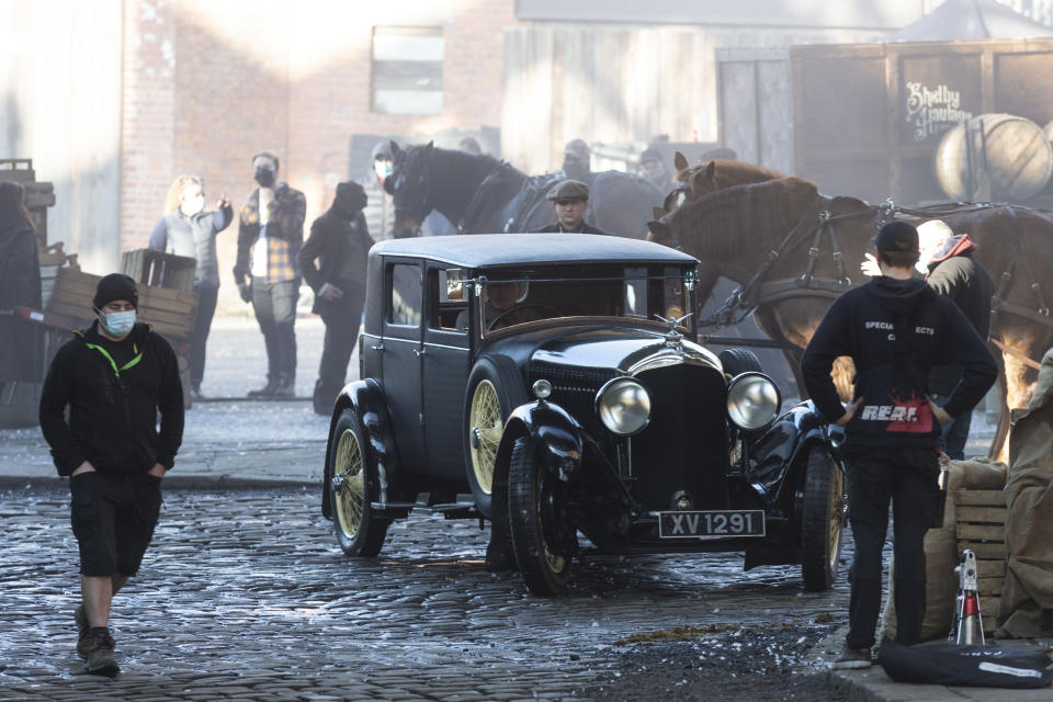 Extra and film crews prepare in between scenes. The filming of Peaky Bliders season 6 continues, in Manchester, pictured in Greater Manchester, March 2 2021. (SWNS)