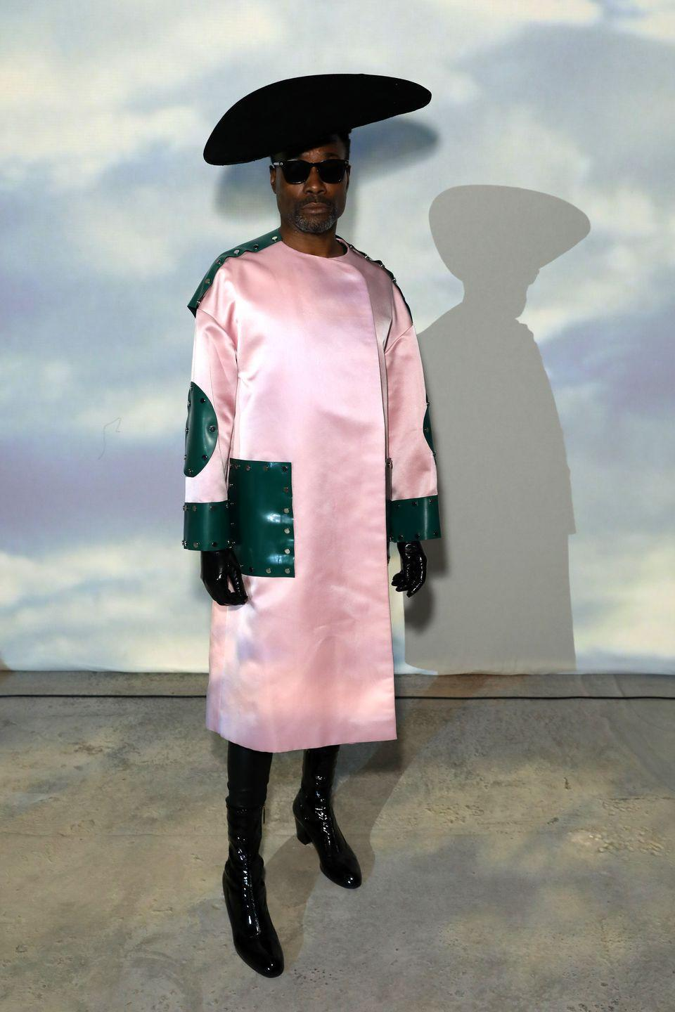 """<p>An appearance at Christopher Kane's SS20 show prompted Porter to opt for a Kane-designed pink coat, Sarah Sokol black hat, Eyevan sunglasses, Gucci black boots and Wing Weft gloves.</p><p>'Love lift us up where we belong,' he captioned a photograph of his outfit on <a href=""""https://www.instagram.com/p/B2g8sHiFV9T/"""" rel=""""nofollow noopener"""" target=""""_blank"""" data-ylk=""""slk:Instagram"""" class=""""link rapid-noclick-resp"""">Instagram</a>. 'Far from the world below. Up where the clear winds blow.'</p>"""