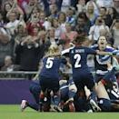 Great Britain's players celebrate after they scored against Brazil during their preliminary round Group E group women's soccer match at Wembley Stadium, during the London 2012 Summer Olympics, in London, Tuesday, July 31, 2012. (AP Photo/Lefteris Pitarakis)