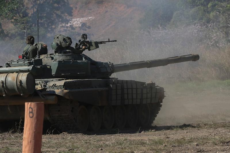 An image released by the Venezuelan presidency shows a Russian-made T-72 tank taking part in military exercises in Carabobo state on January 27, 2019 (AFP Photo/Marcelo GARCIA)