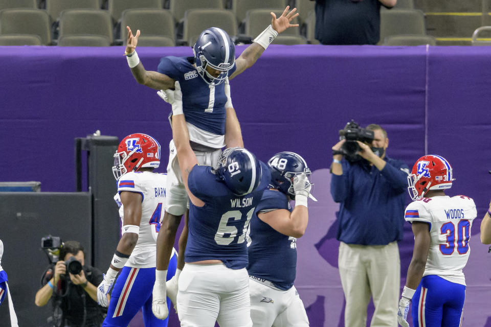 Georgia Southern quarterback Shai Werts (1) is lifted up after scoring a touchdown against Louisiana Tech during the first half of the New Orleans Bowl NCAA college football game in New Orleans, Wednesday, Dec. 23, 2020. (AP Photo/Matthew Hinton)