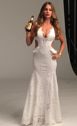 "But Vergara isn't one to only sell beer in a bathing suit. She also sold beer in a super sexy cut-out white gown with a plunging neckline. Obviously. ""Wearing this amazing @marthamedeirosreal dress on the set in [Colombia],"" she wrote alongside the gorgeous pic. (Photo: Instagram)"