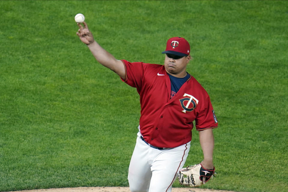 Minnesota Twins' Willians Astudillo moved from catcher to pitcher against the Chicago White Sox in the ninth inning of a baseball game, Monday, May 17, 2021, in Minneapolis. (AP Photo/Jim Mone)