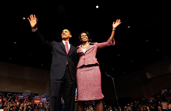 <p>Presidential candidate Sen. Barack Obama (D-IL) (L) and his wife Michelle Obama take the stage after his victory rally at the Columbia Metropolitan Convention Center January 26, 2008 in Columbia, South Carolina. Sen. Barack Obama (D-IL) is the winner of the South Carolina Democratic primary, a critical one for him, followed by Sen. Hillary Clinton (D-NY) with former Sen. John Edwards (D-NC) coming in third. (Photo by Chris Hondros/Getty Images) </p>