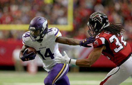 Nov 29, 2015; Atlanta, GA, USA; Minnesota Vikings wide receiver Stefon Diggs (14) runs after a catch against Atlanta Falcons cornerback Jalen Collins (32) in the first quarter of their game at the Georgia Dome. Mandatory Credit: Jason Getz-USA TODAY Sports / Reuters Picture Supplied by Action Images