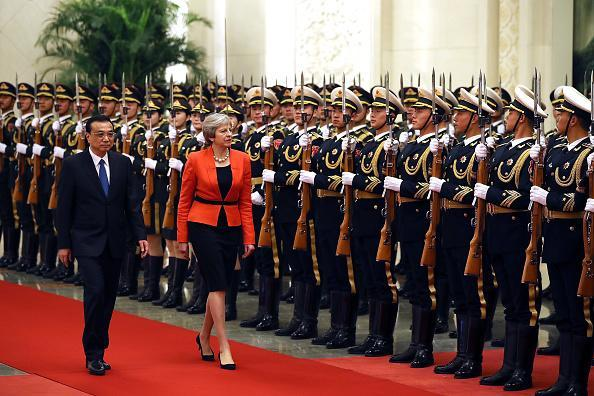 British Prime Minister Theresa May inspects a ceremonial guard with Chinese Premier Li Keqiang in the 'Great Hall of the People' on Jan. 31, 2018 in Beijing. May is being accompanied by a business delegation during her three-day visit to China. May will meet  Keqiang and President Xi Jinping to discuss matters including the environment, investment, education, Hong Kong and North Korea. (Photo by Dan Kitwood/Getty Images)