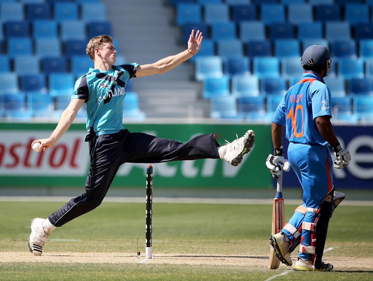 DUBAI, UNITED ARAB EMIRATES - FEBRUARY 17:  Gavin Main of Scotland bowls during the ICC U19 Cricket World Cup 2014 match between India and Scotland at the Dubai Sports City Cricket Stadium on February 17, 2014 in Dubai, United Arab Emirates.  (Photo by Francois Nel - IDI/IDI via Getty Images)