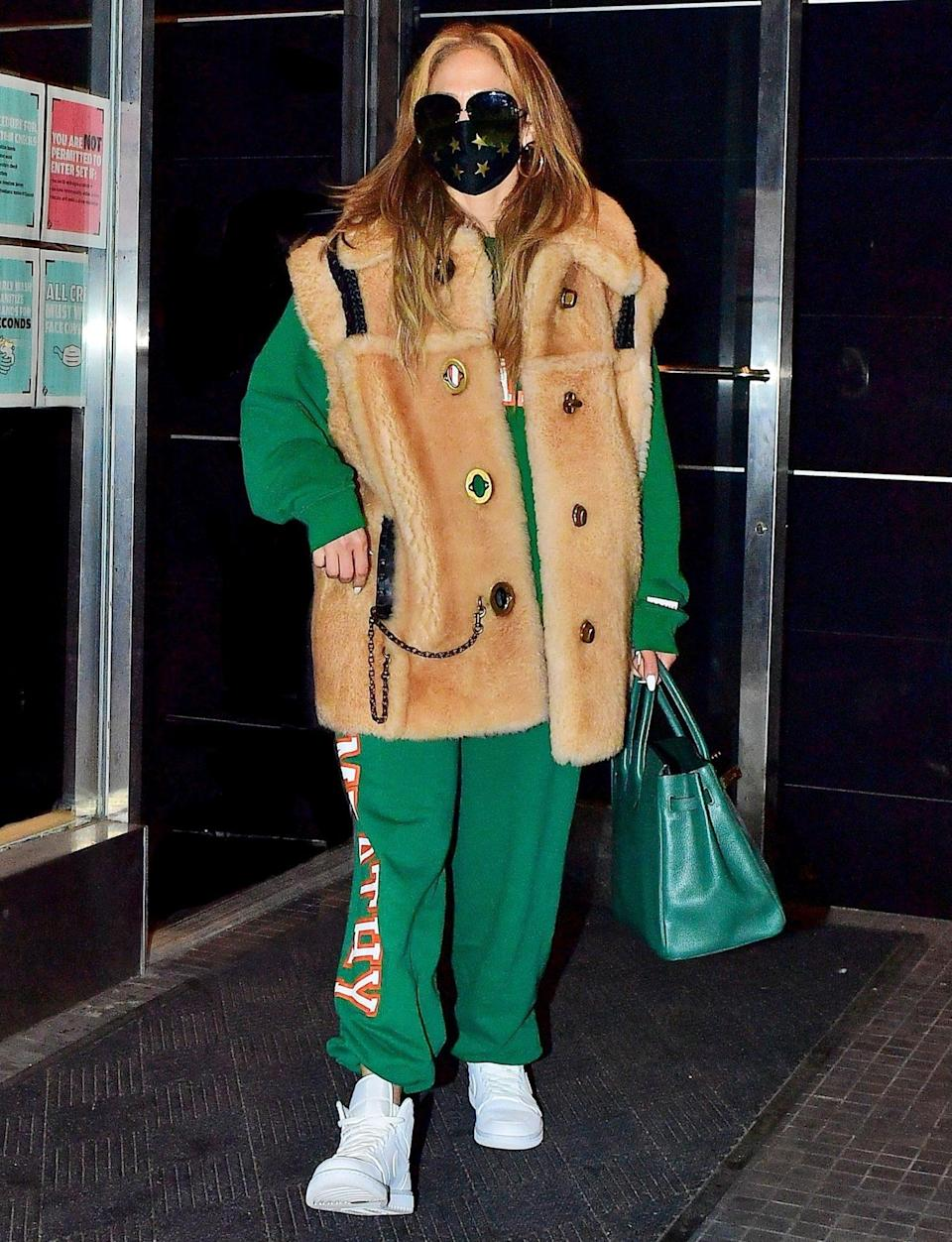 <p>Jennifer Lopez masks up while leaving a studio in New York City on Monday.</p>