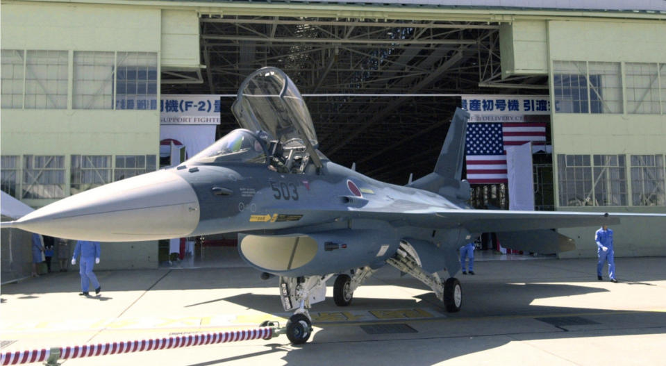 FILE - In this Sept. 25, 2000, file photo, a Japan Air Self-Defense Forces F-2 jet fighter is seen in Toyoyamacho, Aichi Prefecture (state), central Japan. Japan has picked Mitsubishi Heavy Industries as a main contractor to develop the country's own next generation stealth fighter for launch in the 2030s, the defense minister said Friday, Oct. 30, 2020. The next generation stealth jet will replace F-2s that Japan co-developed with the U.S. They are due to be retired around 2035.(Kyodo News via AP, File)