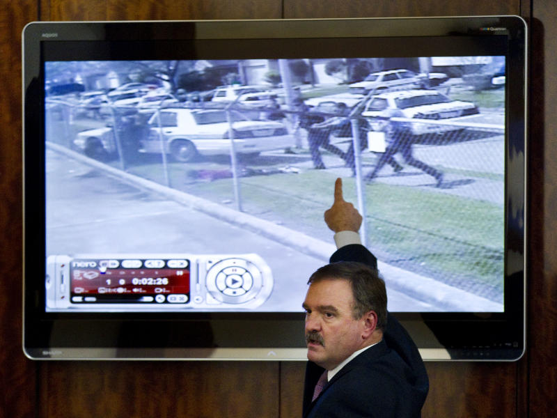 Prosecutor Clint Greenwood points to a video screen as he gives closing arguments during the trial against former Houston police officer Andrew Blomberg Tuesday, May 15, 2012, in Houston. Blomberg is accused of participating in the videotaped beating of a 15-year-old burglary suspect. (AP Photo/Houston Chronicle, Brett Coomer)