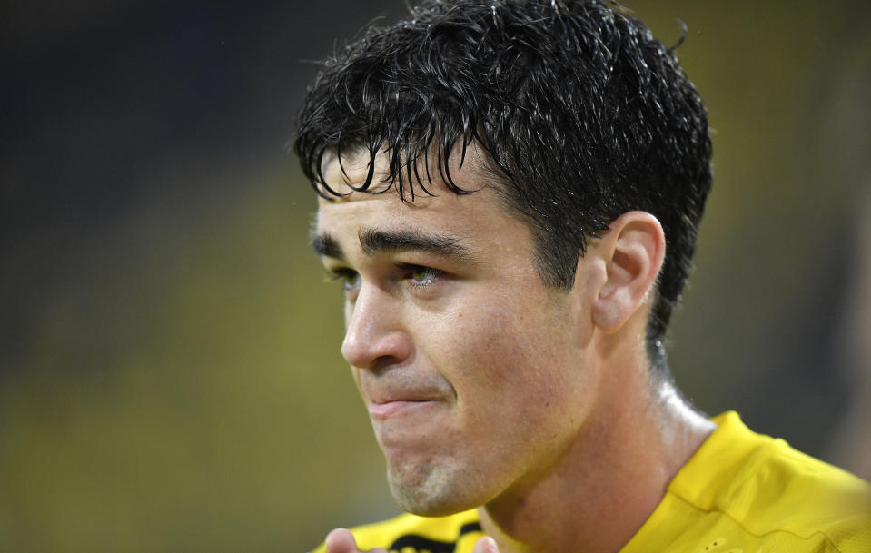 FILE - This Oct., 3, 2020, file photo shows Dortmund's Giovanni Reyna watching during the German Bundesliga soccer match between Borussia Dortmund and SC Freiburg in Dortmund, Germany. Borussia Dortmund said Friday, Nov. 20, 2020, that the 18-year-old Reyna, the youngest American to play in the Bundesliga, signed a new deal through June 2025. (AP Photo/Martin Meissner, File)