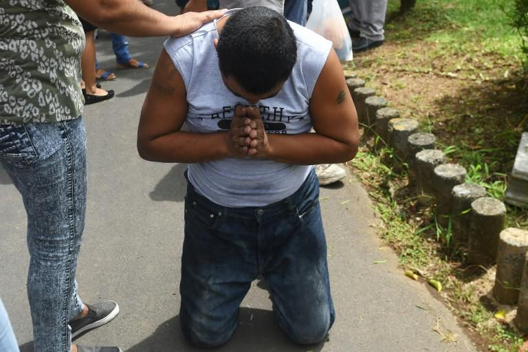 A Nicaraguan man, praying after his release from jail in Managua, was one of 26 protesters freed