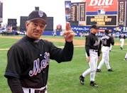 New York Mets manager Bobby Valentine crosses his fingers as he makes his way to the dugout after opening day ceremonies April 3 at New York's Shea Stadium. The Mets got off to a good start, beating the San Diego Padres 2-1.