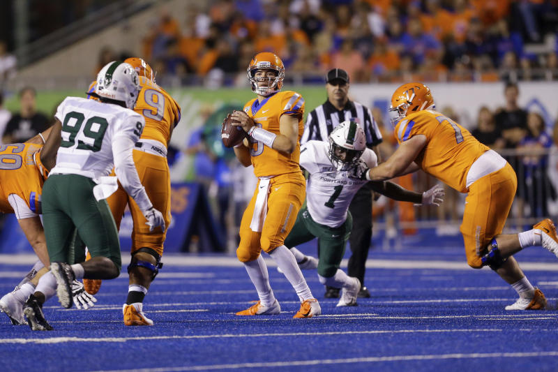 Boise State quarterback Hank Bachmeier (19) looks for a receiver during the first half of the team's NCAA college football game against Portland State, Saturday, Sept. 14, 2019, in Boise, Idaho. (AP Photo/Steve Conner)