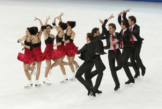 In this multiple exposure photo, Nathalie Pechalat and Fabian Bourzat of France compete in the team ice dance short dance figure skating competition at the Iceberg Skating Palace during the 2014 Winter Olympics, Saturday, Feb. 8, 2014, in Sochi, Russia. (AP Photo/Bernat Armangue)