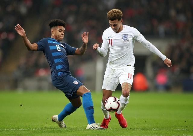 Weston McKennie, left, made his national team debut for the USA as a teenager
