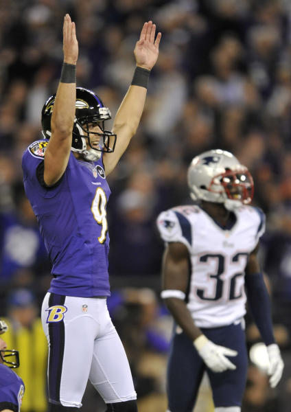 Baltimore Ravens kicker Justin Tucker (9) reacts in front of New England Patriots cornerback Devin McCourty after kicking the game-winning field goal in the final moments of an NFL football game in Baltimore, Sunday, Sept. 23, 2012. Baltimore won 31-30. (AP Photo/Gail Burton)