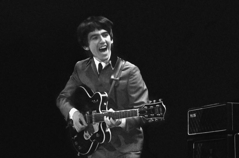 This Feb. 11, 1964 image provided by the David Anthony Fine Art gallery in Taos, N.M., shows a photograph of George Harrison taken by photographer Mike Mitchell during the Beatles first live U.S. concert at the Washington Coliseum. Mitchell's portraits of the Beatles are the centerpiece of a monthlong photography exhibition at the gallery. This marks the first time the images have been shown since their unveiling in 2011 at a Christie's auction in New York City. (AP Photo/David Anthony Fine Art, Mike Mitchell)