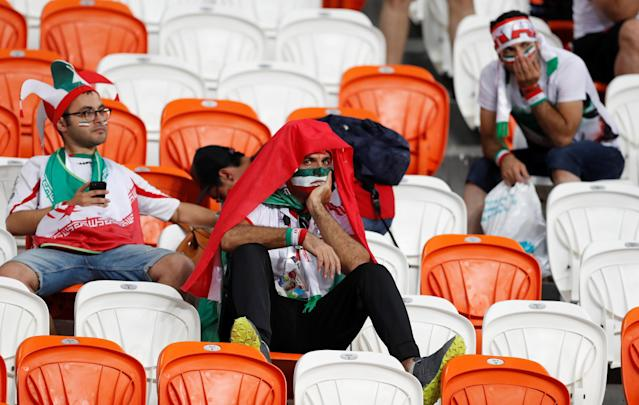 <p>Iran fans look dejected after the match. REUTERS/Matthew Childs </p>