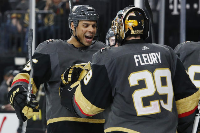 Vegas Golden Knights' Ryan Reaves, left, celebrates with goaltender Marc-Andre Fleury after defeating the Edmonton Oilers in an NHL hockey game Wednesday, Feb. 26, 2020, in Las Vegas. (AP Photo/John Locher)