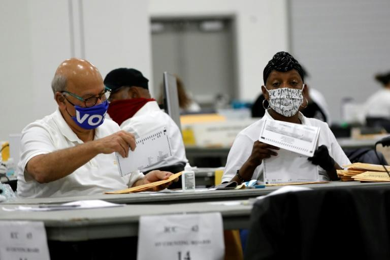 Election workers were still counting votes on Wednesday in many states, especially ballots sent in by mail