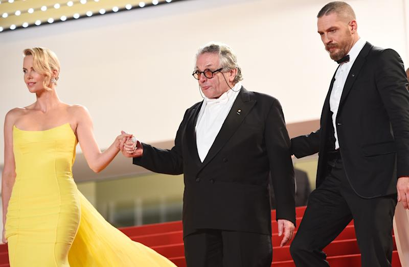 "South African-US actress Charlize Theron (L), Australian director George Miller (C) and US actor Tom Hardy leave the Festival palace after the the screening of the film ""Mad Max : Fury Road"" during the 68th Cannes Film Festival in Cannes, southeastern France, on May 14, 2015. AFP PHOTO / ANNE-CHRISTINE POUJOULAT (Photo credit should read ANNE-CHRISTINE POUJOULAT/AFP via Getty Images)"
