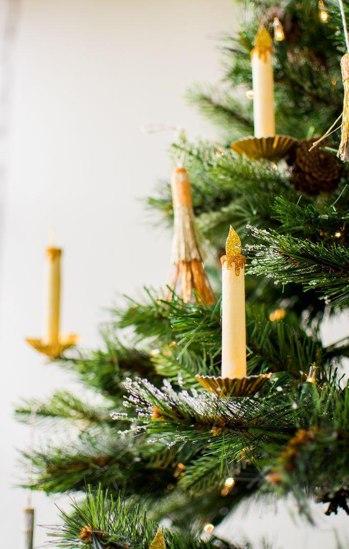 """<p>These timeless paper ornaments almost look like real candles from a distance. Luckily for parents of small children though, these ones are far less dangerous.</p><p><strong>Get the tutorial at <a href=""""http://thehousethatlarsbuilt.com/2017/11/paper-candle-christmas-tree-ornament.html/"""" rel=""""nofollow noopener"""" target=""""_blank"""" data-ylk=""""slk:The House That Lars Built"""" class=""""link rapid-noclick-resp"""">The House That Lars Built</a>.</strong></p><p><strong><strong><a class=""""link rapid-noclick-resp"""" href=""""https://www.amazon.com/Sheets-Origami-Paper-Colors-inches/dp/B07477TX65?tag=syn-yahoo-20&ascsubtag=%5Bartid%7C10050.g.1070%5Bsrc%7Cyahoo-us"""" rel=""""nofollow noopener"""" target=""""_blank"""" data-ylk=""""slk:SHOP COLORED PAPER"""">SHOP COLORED PAPER</a></strong><br></strong></p>"""
