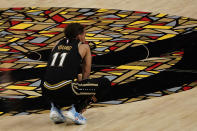 Atlanta Hawks guard Trae Young (11) watches as the Philadelphia 76ers shoot free throws in the final moments during the second half of Game 6 of an NBA basketball Eastern Conference semifinal series Friday, June 18, 2021, in Atlanta. (AP Photo/John Bazemore)