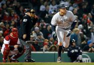 New York Yankees' Aaron Judge heads to first with a solo home run during the fifth inning of a baseball game against the Boston Red Sox in Boston, Tuesday, April 10, 2018. (AP Photo/Michael Dwyer)
