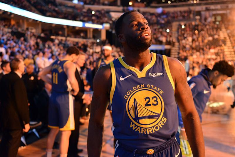 Golden State Warriors forward Draymond Green (23) stands on the court during player introductions before an NBA basketball game against the Memphis Grizzlies Wednesday, March 27, 2019, in Memphis, Tenn. (AP Photo/Brandon Dill)
