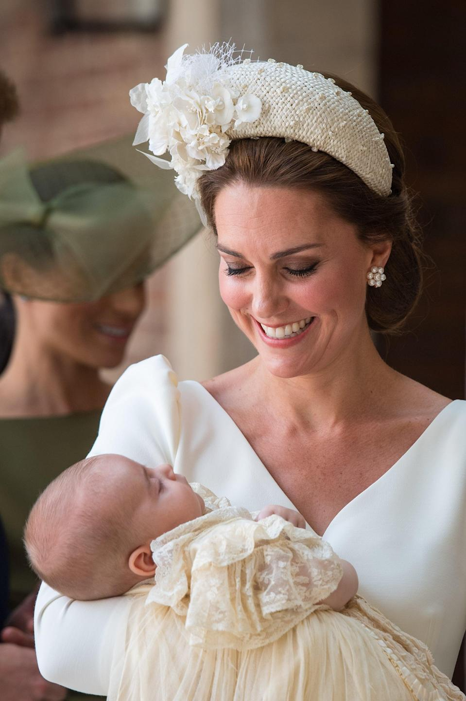 "<p><a href=""https://www.popsugar.com/celebrity/Prince-Louis-Christening-Photos-45011790"" class=""link rapid-noclick-resp"" rel=""nofollow noopener"" target=""_blank"" data-ylk=""slk:Prince Louis's christening"">Prince Louis's christening</a> was the perfect occasion for the duchess to breakout a bespoke headband designed from <a href=""https://www.janetaylorlondon.com/category/hat-style/headbands/?swoof=1&pa_material=beaded&really_curr_tax=426-product_cat"" class=""link rapid-noclick-resp"" rel=""nofollow noopener"" target=""_blank"" data-ylk=""slk:Jane Taylor London"">Jane Taylor London</a>. And as usual, the duchess styled her hair in a low chignon/loop, which acts as both an anchor for the large accessory and a way to expose her beautiful earrings. </p>"