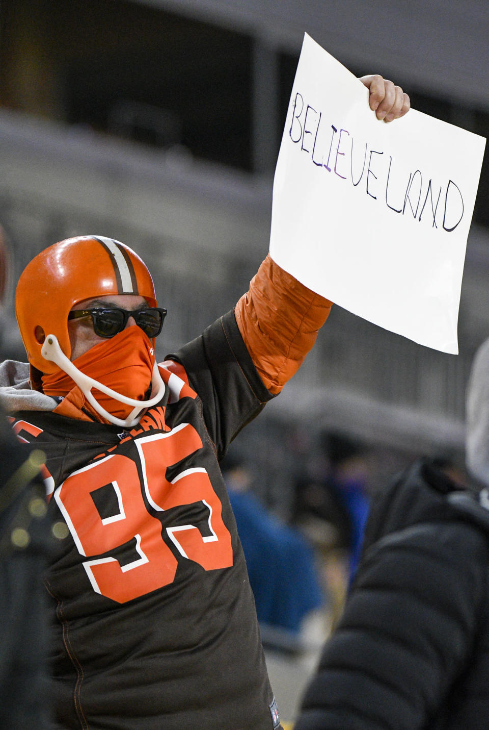 CORRECTS TIME OF PHOTO TO LATE SUNDAY, JAN. 10 INSTEAD OF EARLY MONDAY, JAN. 11 - A Cleveland Browns fan holds a sign after an NFL wild-card playoff football game between the Pittsburgh Steelers and the Cleveland Browns in Pittsburgh, late Sunday, Jan. 10, 2021. The Browns won 48-37. (AP Photo/Don Wright)