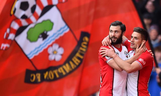 Dusan Tadic (right) celebrates with Charlie Austin after setting Southampton on course for a crucial, nail-biting victory over Bournemouth.
