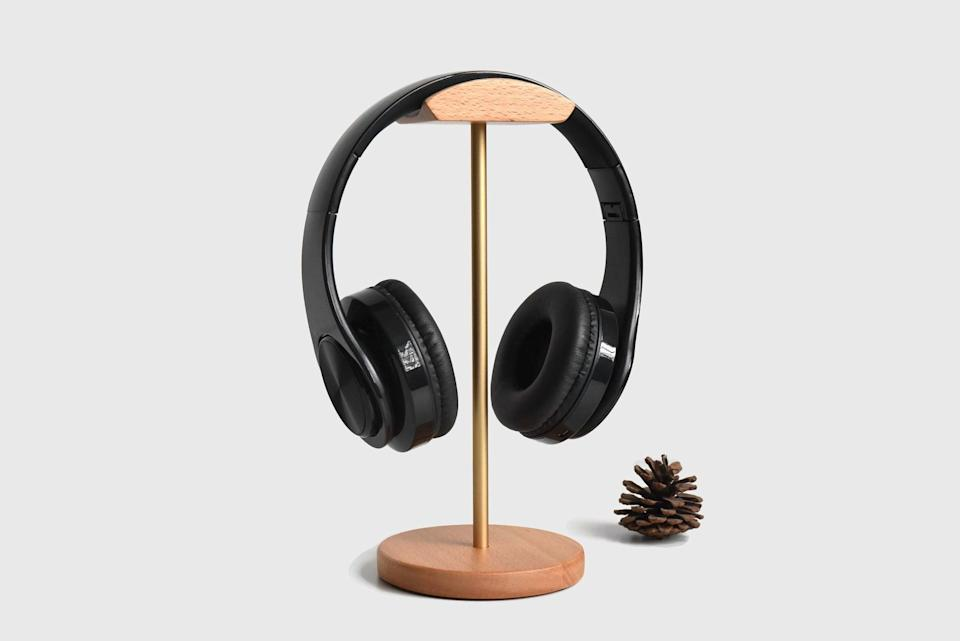 <p>Give their headphones a home with the <span>Custom Wooden and Metal Headphone Stand</span> ($26, and up) is perfect for storing them properly. They can use this stand to keep their over-the-ear headphones or wired earphones in a proper place and treat them with care. Plus, it will make their desk or bedside table look put together. </p>