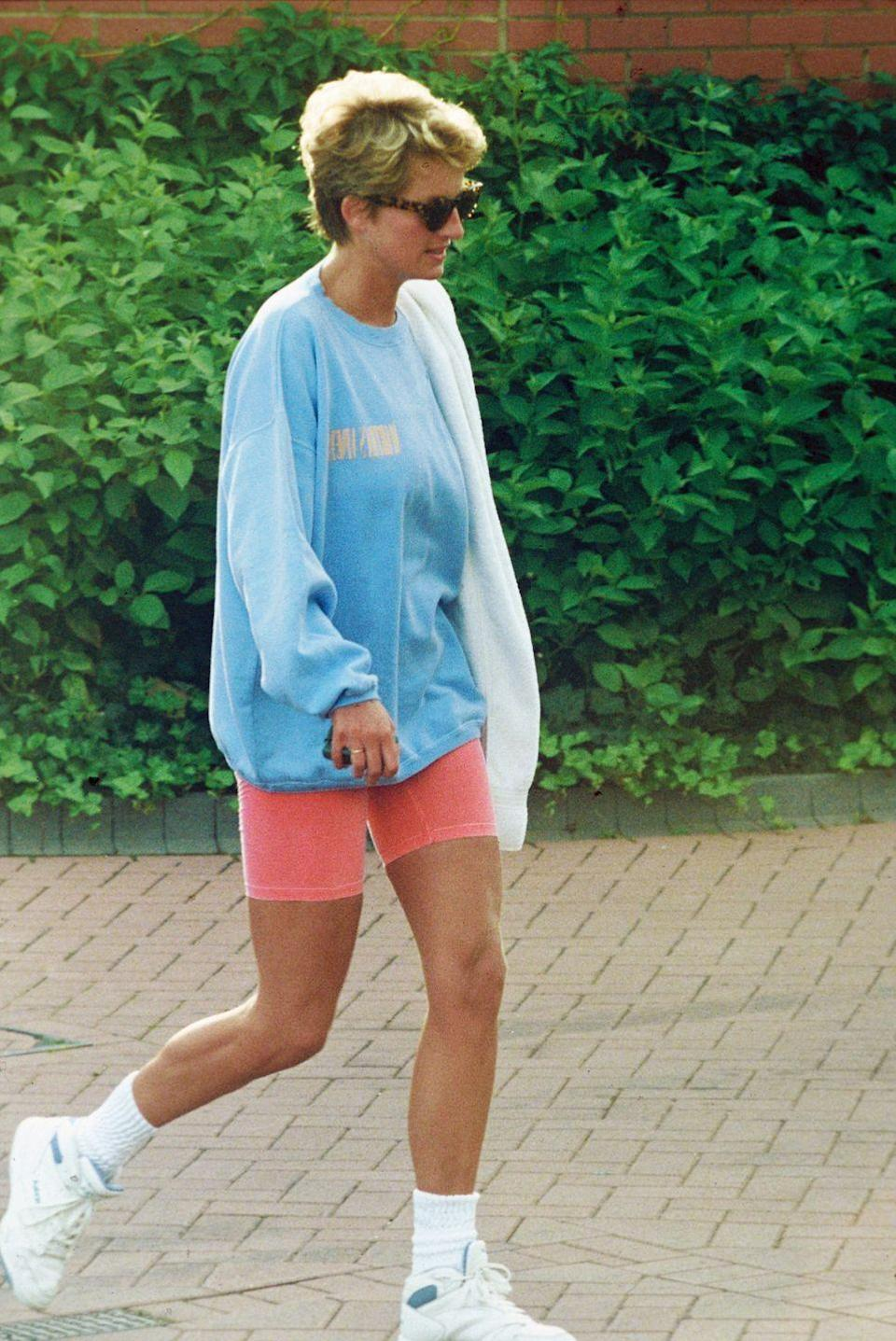 <p>Diana went for contrast with her blue and orangey-red outfit, though always opted for neutral accessories. Case in point? Her white sneakers and tortoise shell sunglasses. </p>