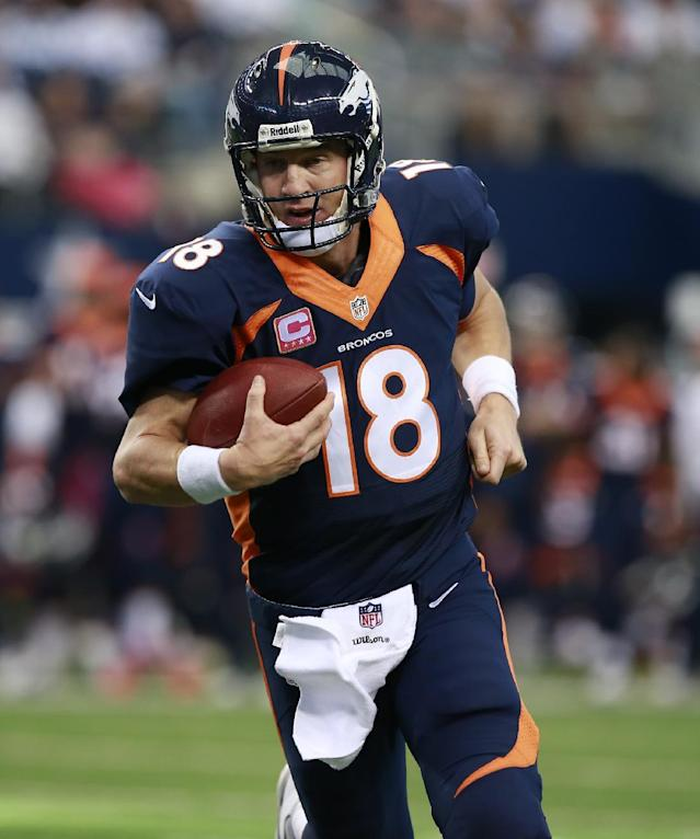 Denver Broncos quarterback Peyton Manning (18) scores a touchdown during the first half of an NFL football game Sunday, Oct. 6, 2013, in Arlington, Texas. The Broncos won 51-48. (AP Photo/Waco Tribune Herald, Jose Yau)