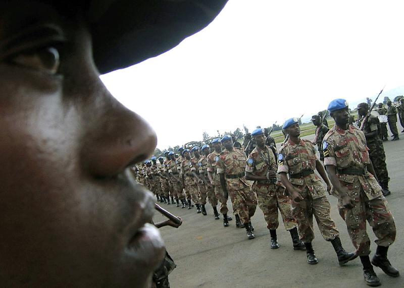 A key player in peacekeeping in Africa, Rwanda, whose troops are pictured on November 22, 2005, offered two attack helicopters, two field hospitals, an all-female police unit and 1,600 new troops (AFP Photo/Jose Cendon)