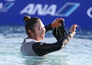 Patty Tavatanakit of Thailand celebrates after winning the ANA Inspiration by jumping into into the greenside pond at the 18th hole