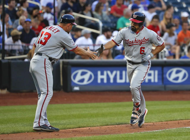 Washington Nationals' Anthony Rendon (6) is congratulated by third base coach Bob Henley (13) after hitting a solo home run against the New York Mets during the third inning of a baseball game Thursday, July 12, 2018, in New York.(AP Photo/Julie Jacobson)