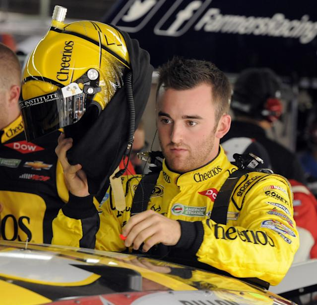 Austin Dillon prepares before practice for Sunday's NASCAR Sprint Cup series Coca-Cola 600 auto race at Charlotte Motor Speedway in Concord, N.C., Thursday, May 22, 2014. (AP Photo/Mike McCarn)